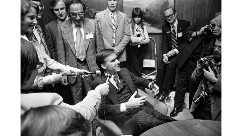 Nov. 6, 1974: Gov.-elect Jerry Brown talks with reporters at his campaign headquarters in Los Angeles shortly before giving his victory speech.