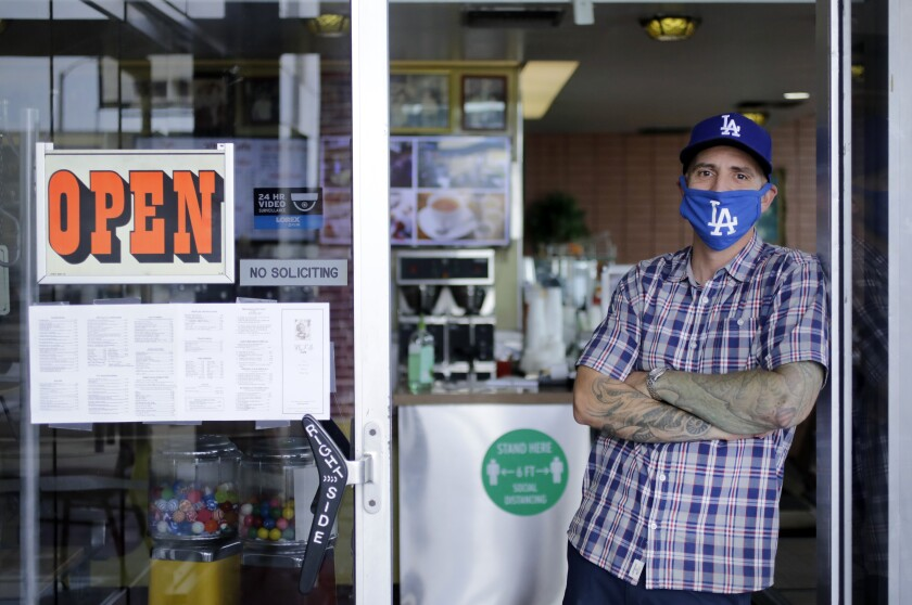 Ryan Hagen, who started a GoFundMe page for the owners, Paul and Lucy Ma, stands in the doorway at VIP's Cafe.
