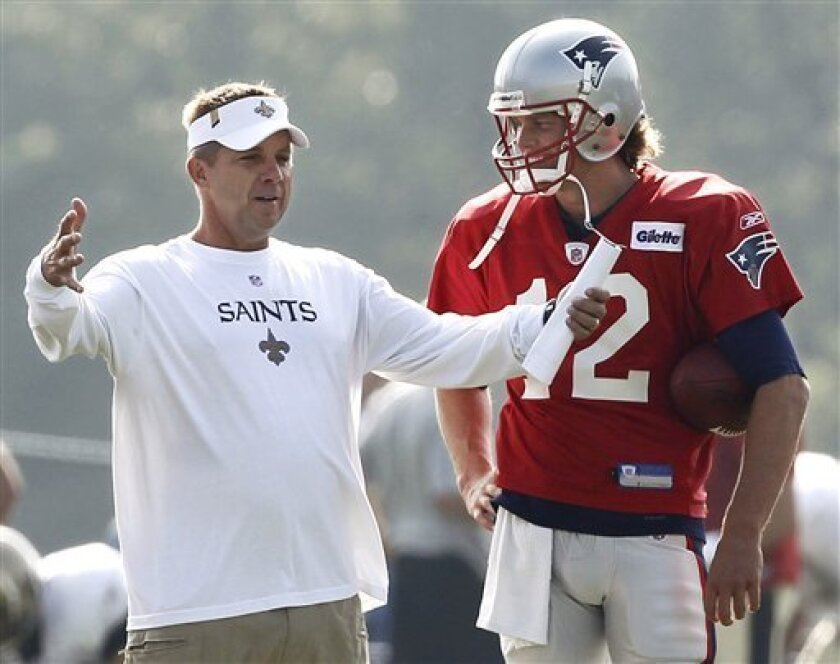 New Orleans Saints head coach sean Payton chats with New England Patriots quarterback Tom Brady during a joint football practice in Foxborough, Mass. Tuesday, Aug. 10, 2010. (AP Photo/Winslow Townson)