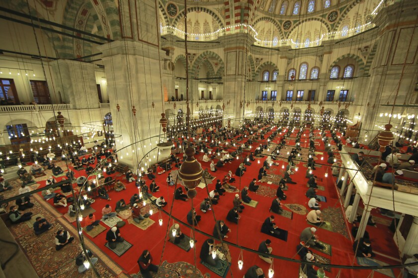 Muslims offer prayers during the first day of Eid al-Fitr, which marks the end of the holy month of Ramadan at Fatih Mosque in Istanbul, Thursday, May 13, 2021. Hundreds of Muslims attended dawn Eid al-Fitr prayers Thursday marking the end of the month of prayer and fasting for Muslims around the world, a usually joyous three-day celebration that has been significantly toned down as coronavirus cases soar. (AP Photo/Emrah Gurel)