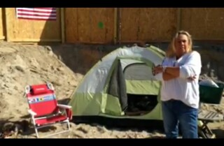 Sandy victim camps out where home once stood