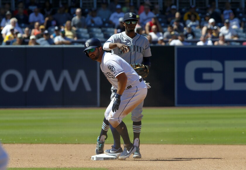 Padres utility man Greg Garcia slides into second base against the Mariners on Wednesday.