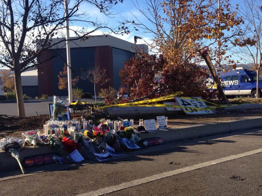 A makeshift memorial grows at the site where actor Paul Walker was killed in a fiery crash Saturday.