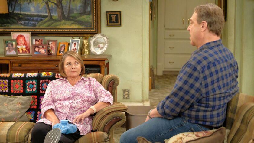 "Roseanne Barr, left, with John Goodman on ""Roseanne."""