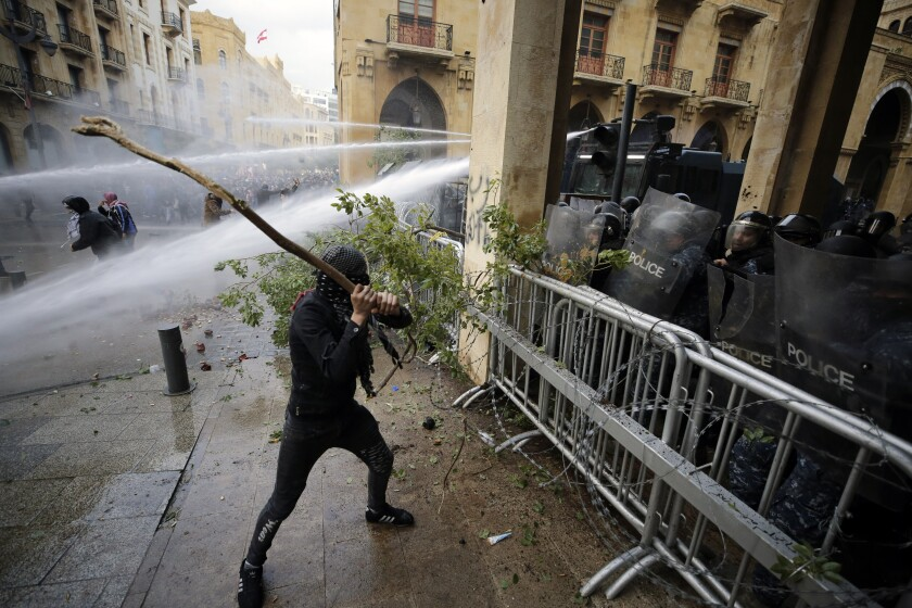 Riots broke out during a march against the ruling elite in Beirut, Lebanon, on  Jan. 18, 2020.
