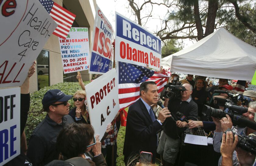 Rep. Darrell Issa, R-Vista, addresses people gathered outside of his Vista office on the morning of Feb. 21, 2017.