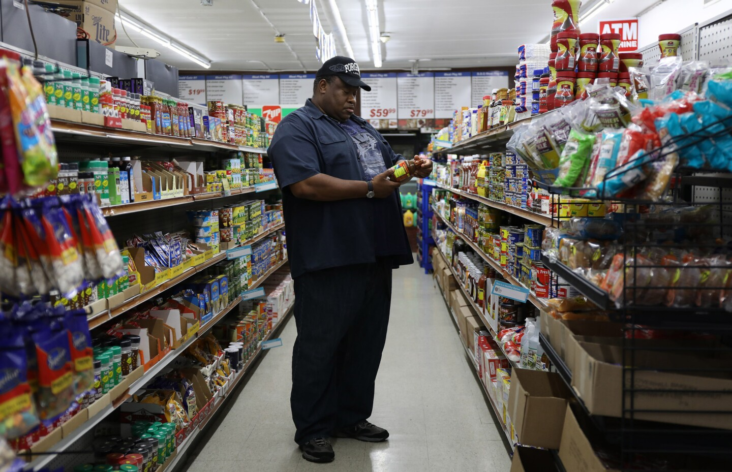 Carey Grimmage, of Calumet Park, shops June 16, 2017, at Jordan Food Mart in Calumet Park. The store carries frozen meats, not fresh, but owner Luay Madain said he may bring back fresh meat if residents demand it, now that Ultra Foods has closed its doors in Calumet Park.