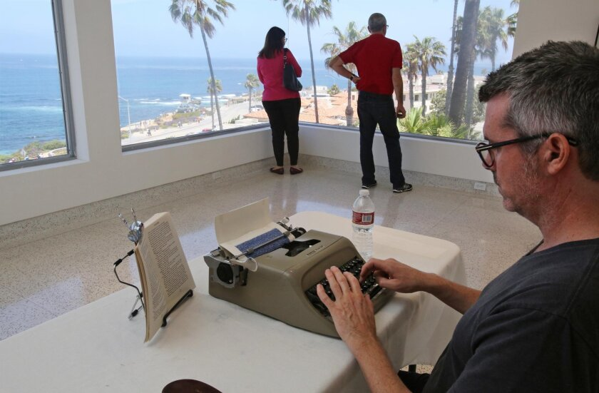 Artist Tim Youd types a diptych of the novel, The Long Goodbye by Raymond Chandler, on a Olivetti Studio 44 typewriter, the same model as Chandler used on The Long Goodbye, Saturday at the Museum of Contemporary Art in La Jolla in a room overlooking the ocean as some museum visitors enjoy the view. photo by Bill Wechter