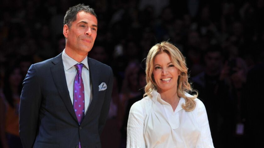 Lakers general manager Rob Pelinka and owner Jeanie Buss attend Kobe Bryant's jersey retirement ceremony in December 2017. Buss says she's completely confident in Pelinka running the team.