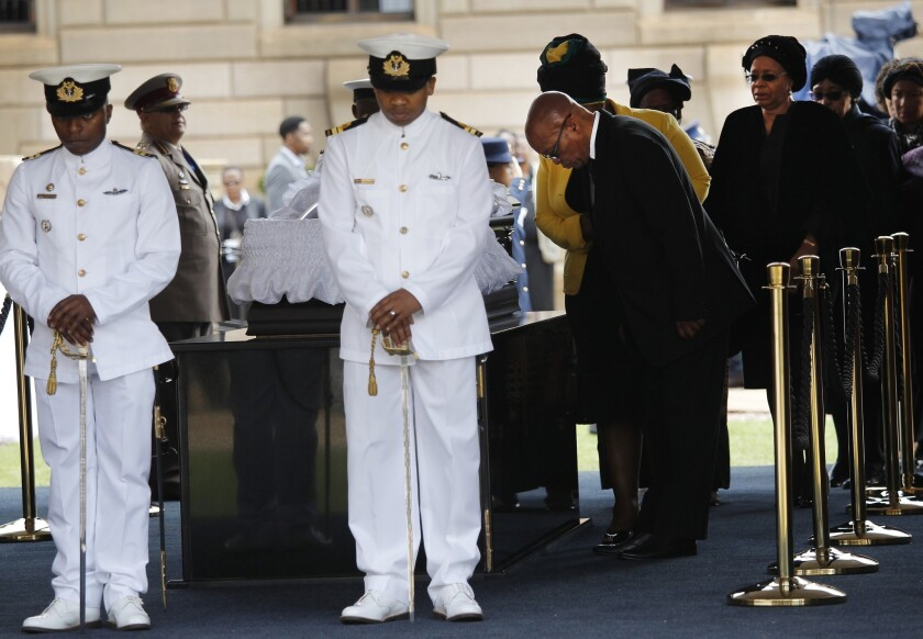 South African President Jacob Zuma pays his respects as the body of former President Nelson Mandela lies in state at the Union Buildings in Pretoria.