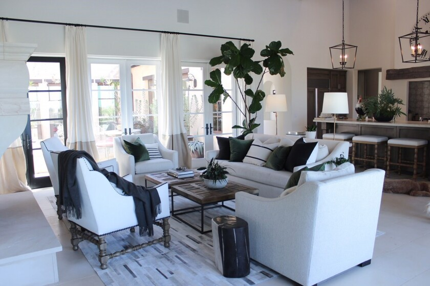 A thoughtfully ribboned color palette of white, oyster and charcoal gray create an easy flow from ro