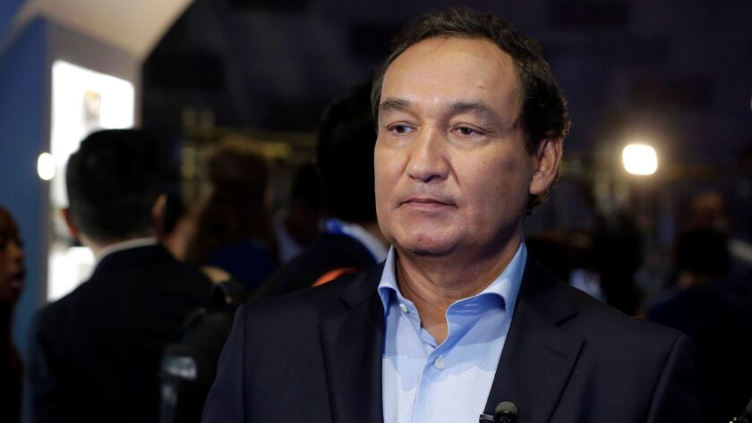 FILE - In this Thursday, June 2, 2016, file photo, United Airlines CEO Oscar Munoz waits to be inter