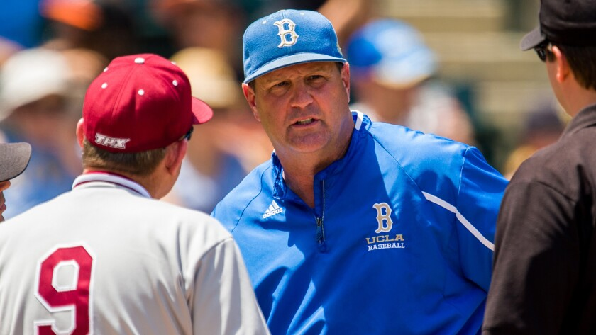 UCLA Coach John Savage speaks to Stanford Coach Mark Marquess and umpires during a game against Stanford in 2014.