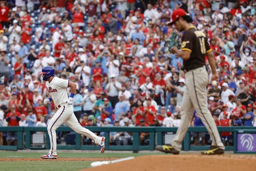 The Phillies' Rhys Hoskins runs bases after hitting a solo home run off the Padres' Yu Darvish