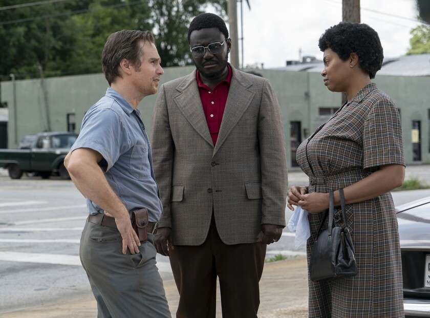 """Sam Rockwell, left, and Taraji P. Henson costar in the fact-based drama """"The Best of Enemies."""" With Babou Ceesay."""