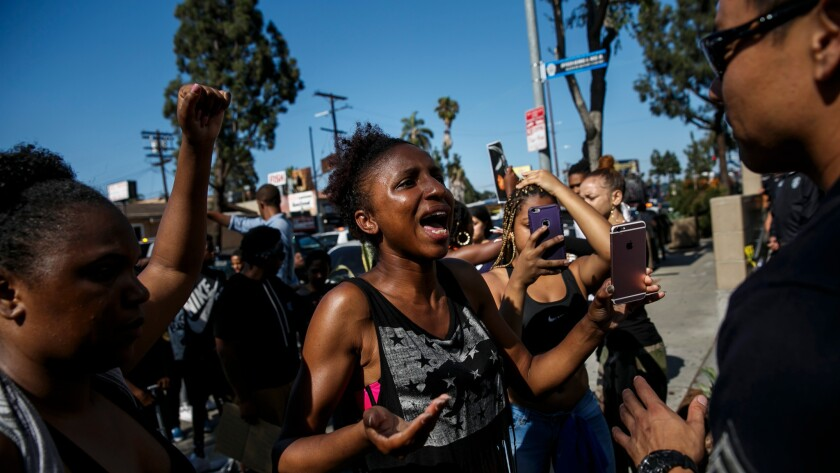 Protesters talk voice their concerns to LAPD officers after the recent deaths of Alton Sterling and Philando Castile, at the hands of the police in other states, in Los Angeles on July 7.