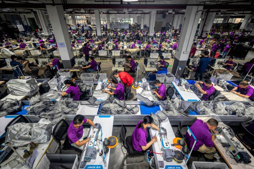 Workers churn out nursery products at the Wonderland company in Dongguan, China.