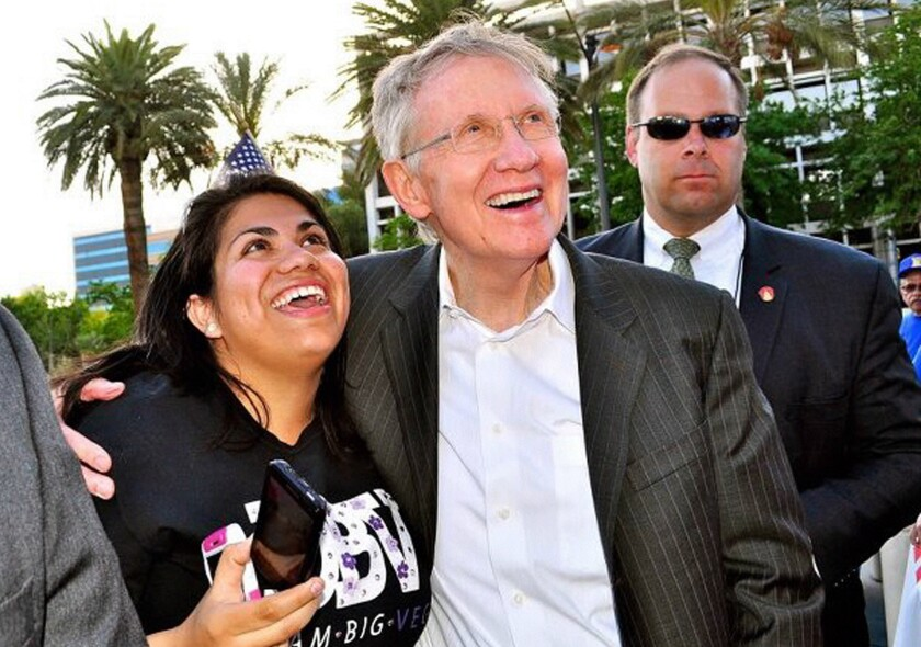 Silva and Reid at rally in Las Vegas in May.