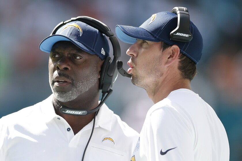 Chargers coaches Anthony Lynn, left, and Shane Steichen during a game against the Dolphins on Sept. 29.