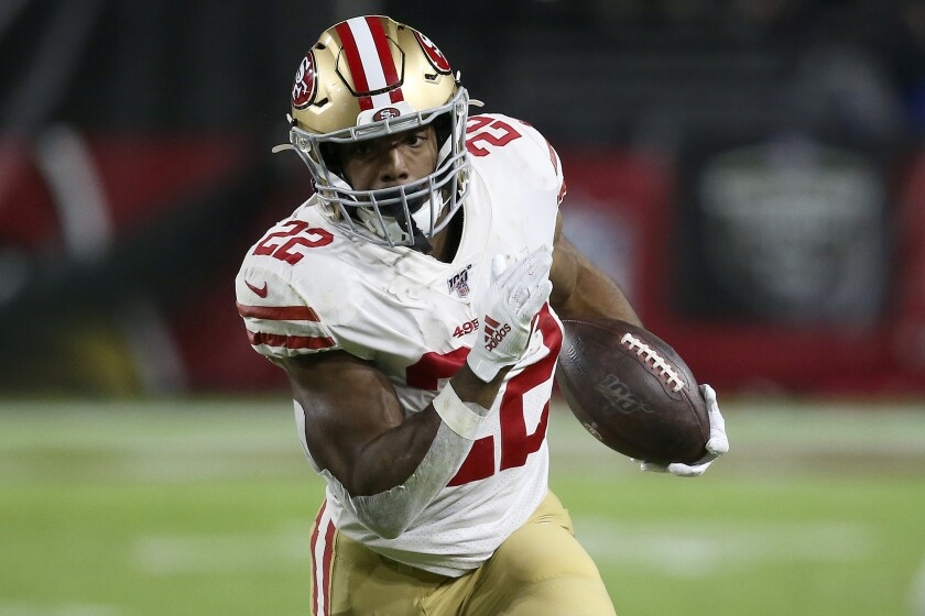 FILE - In this Oct. 31, 2019, file photo, San Francisco 49ers running back Matt Breida (22) carries the ball against the Arizona Cardinals during the first half of an NFL football game in Glendale, Ariz. The Dolphins believe veteran newcomers Jordan Howard and Matt Breida represent a significant upgrade at the position, providing more punch and versatility for an offense that last year had the NFL's lowest rushing total since 2006. (AP Photo/Ross D. Franklin, FIle)