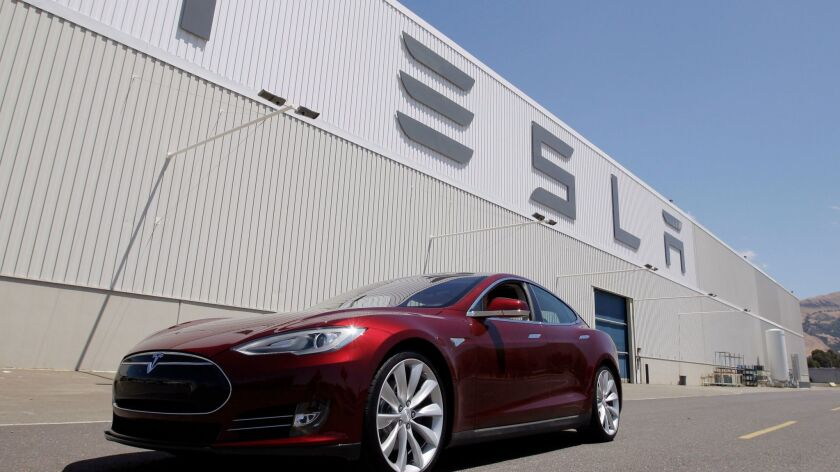 FILE - This June 22, 2012 file photo shows a Tesla Model S outside the Tesla factory in Fremont, Cal