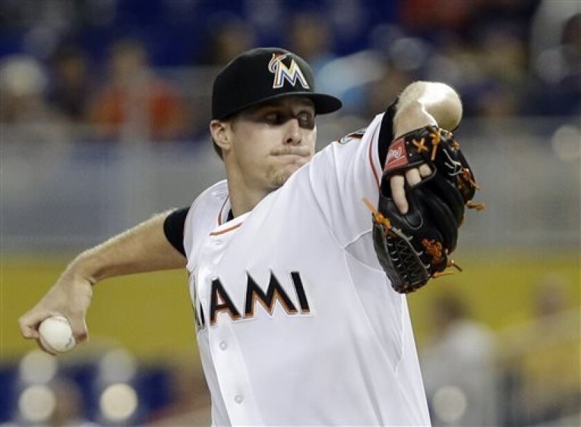 Miami Marlins' Tom Koehler delivers a pitch during the first inning of a baseball game against the New York Mets, Thursday, Aug. 1, 2013 in Miami. (AP Photo/Wilfredo Lee)