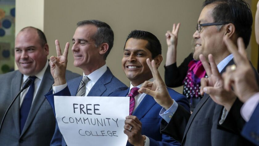 Assemblyman Miguel Santiago, holding sign, is a proponent of AB-2 that gives two years of tuition-free community college.