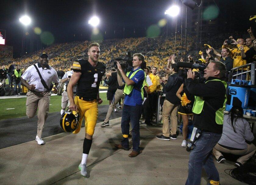 Iowa placekicker Marshall Koehn (1) runs back into the locker room after kicking an NCAA college football game-winning field goal to defeat Pittsburgh, Saturday, Sept. 19, 2015, in Iowa City, Iowa. (AP Photo/Justin Hayworth)