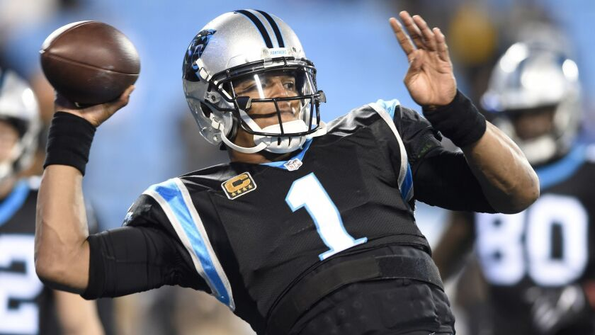 FILE - In this Monday, Dec. 17, 2018 file photo, Carolina Panthers' Cam Newton (1) warms up before a