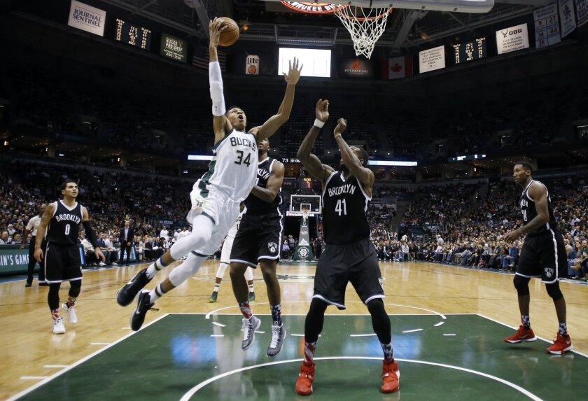 Milwaukee Bucks' Giannis Antetokounmpo shoots past Brooklyn Nets' Thomas Robinson (41) during the second half of an NBA basketball game Saturday, Nov. 7, 2015, in Milwaukee. The Bucks won 94-86. (AP Photo/Morry Gash)