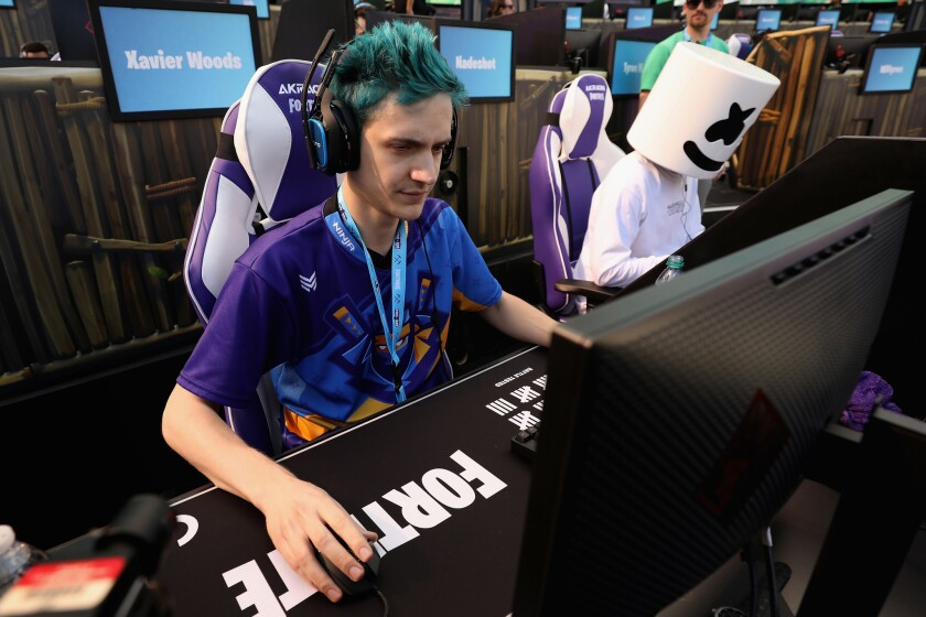 """Gamers """"Ninja,"""" left, and """"Marshmello"""" compete in the Epic Games Fortnite E3 Tournament in Los Angeles on June 12."""