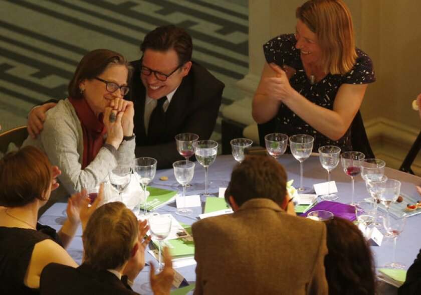 Lydia Davis, left, reacts as she is announced as the winner of the Man Booker International Prize at an award ceremony in London.