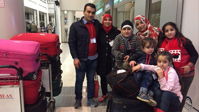 Mohammed Ali, wife Kinda Nonoo and their children, Ali, 14; Mais, 15; Bader, 2; Ghima, 7; and Ghazal