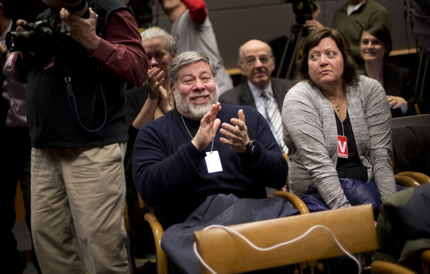"""Apple co-founder Steve Wozniak and his wife Janet Hill at Federal Communications Commission's open hearing on """"net neutrality"""" Thursday."""