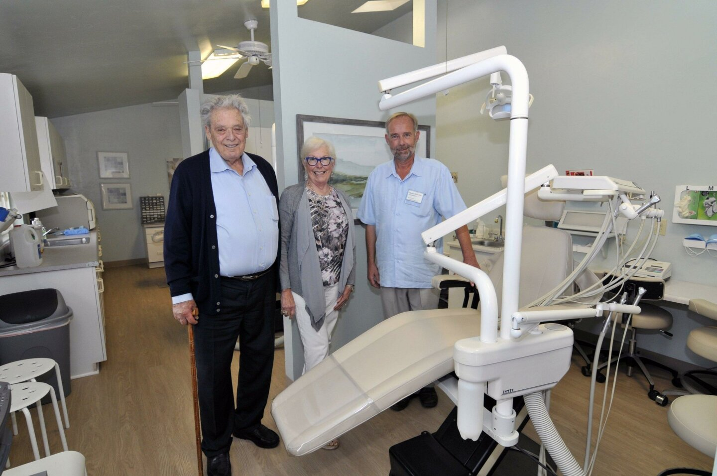 Malcolm McQueen and Ruby Edman tour the new facility with St. Leo's Dental Clinic board member Klaus Gubernator