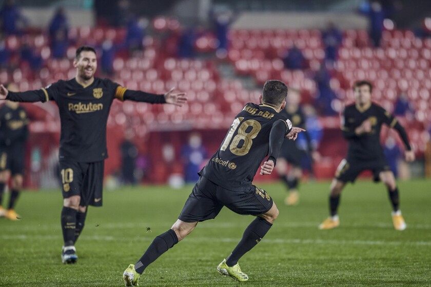 Barcelona's Jordi Alba celebrates after scoring his side's fifth goal with teammates during a Spanish Copa del Rey quarter finals soccer match between Granada and FC Barcelona at the Los Carmenes stadium in Granada, Spain, Wednesday, Feb. 3, 2021. (AP Photo)