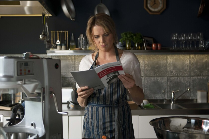 "Lucy Lawless, bread maker,  in ""My Life Is Murder"""