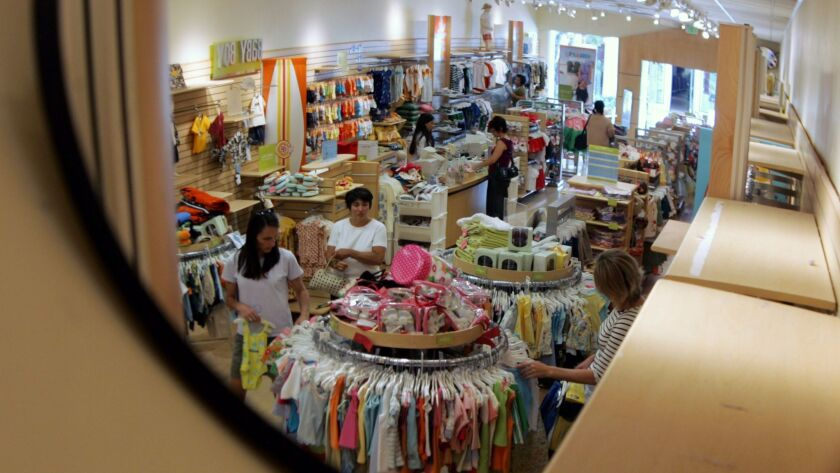 A security mirror shows shoppers at a Gymboree store in Palo Alto, Calif., in 2005.