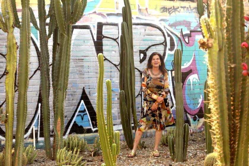 Landscape designer Mia Lehrer, founder of Studio-MLA, stands in a cactus garden adjacent to her studio