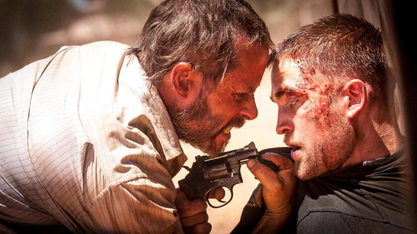 """Guy Pearce, left, and Robert Pattinson star in """"The Rover."""""""