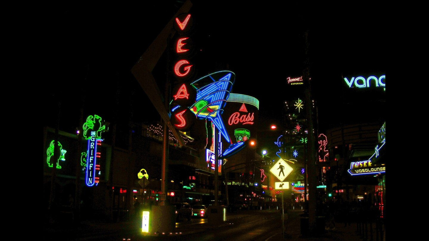 Bright lights, big city: Approaching the Fremont Street Experience in Las Vegas.