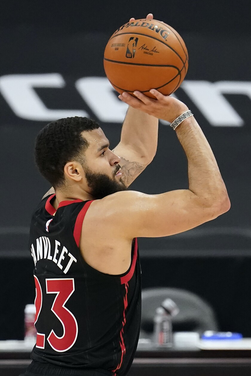 Toronto Raptors guard Fred VanVleet (23) puts up a shot against the Philadelphia 76ers during the second half of an NBA basketball game Sunday, Feb. 21, 2021, in Tampa, Fla. (AP Photo/Chris O'Meara)