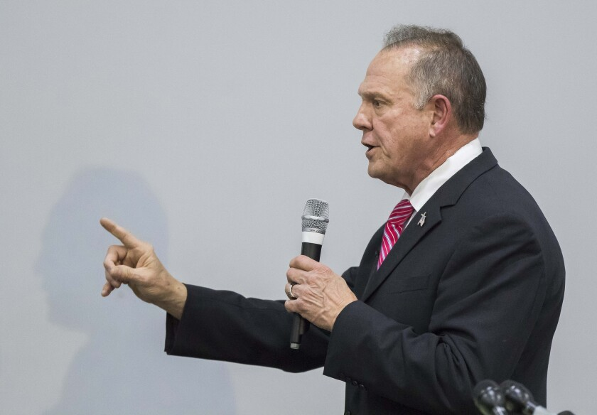 Judge Roy Moore, the Republican nominee for US Senate in Alabama, speaks at the God Save American Revival Conference at Walker Springs Road Baptist Church in Jackson, Alab., on Nov. 14, 2017. Moore's communications director, John Rogers, resigned on Nov. 22.