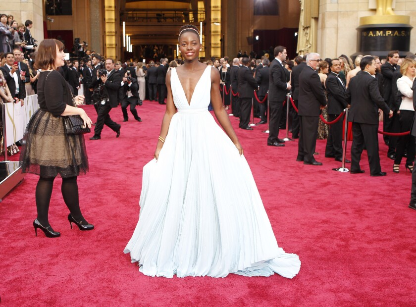 "Lupita Nyong'o, who won the supporting actress award for ""12 Years a Slave,"" wore a custom Prada light blue silk gown to the Oscars."