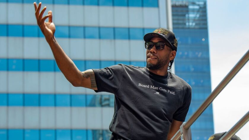 NBA Finals MVP Kawhi Leonard takes part in the victory parade in Toronto after winning the title. Will Leonard join LeBron James and Anthony Davis on the Lakers this season?