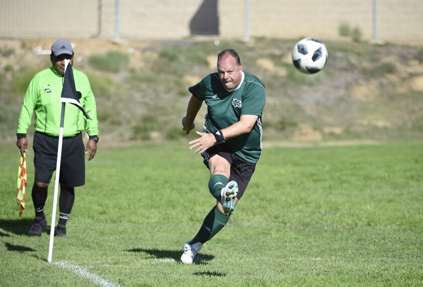 Gerhard Neuendorff takes a corner kick while playing in a league soccer game.