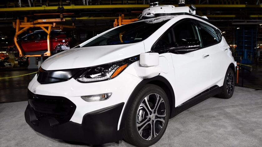 A self-driving Chevrolet Bolt EV is on display at a General Motors assembly plant in Lake Orion, Mich.
