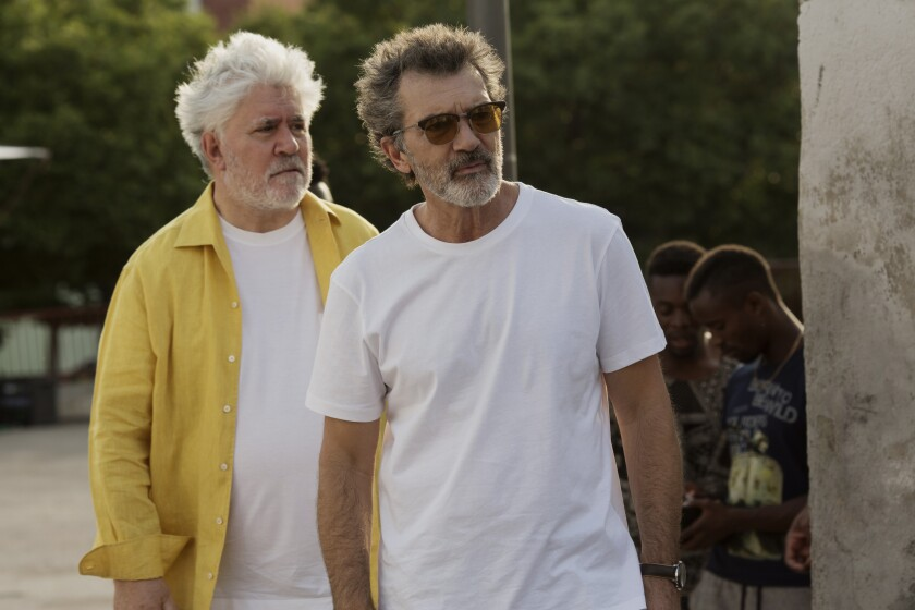"Director Pedro Almodóvar and his lead actor Antonio Banderas on the set of ""Pain and Glory."""