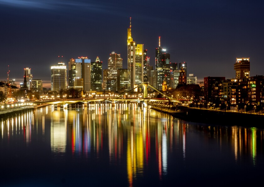 FILE - In this Feb.14, 2021 file photo the lights of the bridges and buildings are reflected in the river Main in Frankfurt, Germany. Europe's economy has rebounded into growth in the second quarter. (AP Photo/Michael Probst)
