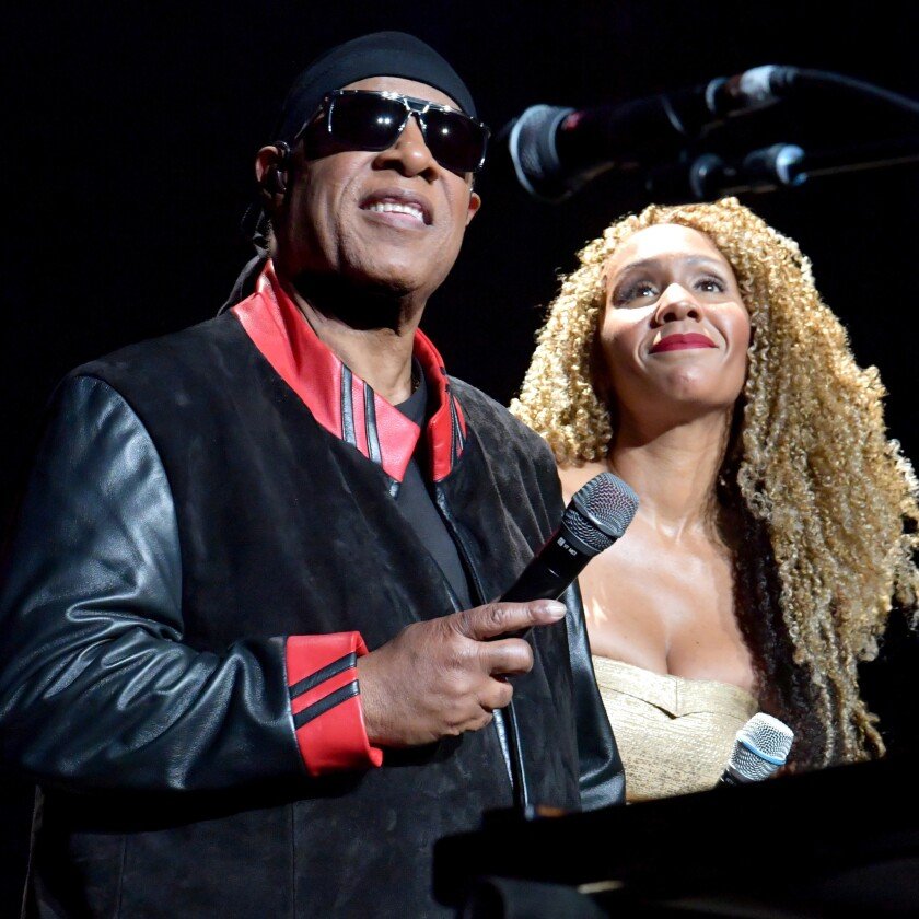 Stevie Wonder and daughter Aisha Morris onstage Sunday during Wonder's annual House Full of Toys benefit concert at Staples Center.
